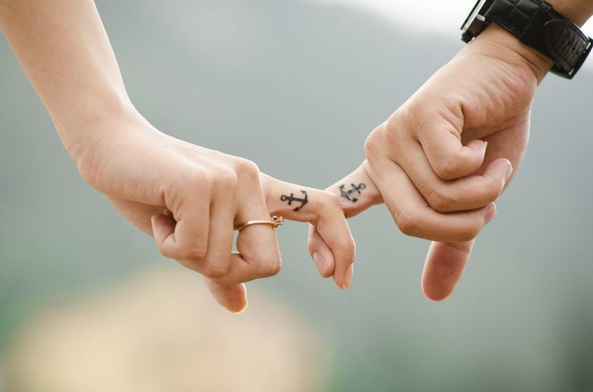 Image of a Couple Holding Hands